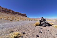 Stone pyramid in the desert. Pile of rocks forming a pyramid in the middle of the Atacama desert Stock Photos