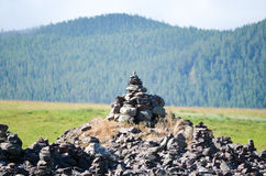 Stone pyramid of desires from stones in the mountains. Stock Photo