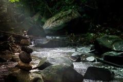 Stone pyramid forest river balance rocks. Lights Royalty Free Stock Image