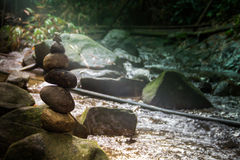 Stone pyramid forest river balance rocks. Lights Stock Image