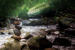Stone pyramid forest river balance rocks. Lights Royalty Free Stock Photography