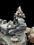 Stone Pyramid Over Black. Pyramid made from small pieces of rocks of different sizes and shapes isolated over black background Stock Images