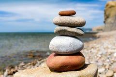 Stone pyramid of pebble on sea Stock Photo