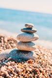 Stone pyramid on pebbles on beach. Zen rock - balance and harmony royalty free stock image