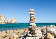 Stone pyramid on the Praia do Barranco Beach. Sagres Vila do Bispo, Algarve, Southern Portugal. Balance and harmony concept. Zen Royalty Free Stock Images