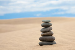 Stone pyramid on sand Royalty Free Stock Image