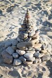 Stone pyramid on the sand. In the beach Royalty Free Stock Photography