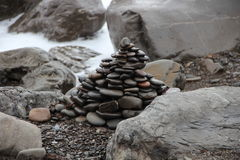 Stone pyramid, the sea. Stone pyramid on a sea beach Stock Photo
