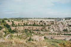 Stone quarry with excavate - Open pit mine royalty free stock photography