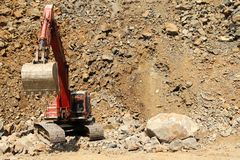 Stone quarry excavator Royalty Free Stock Image