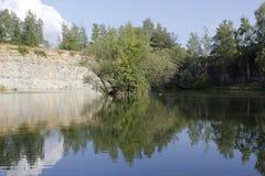 Stone quarry lake Royalty Free Stock Images