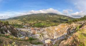 Stone quarry in the mountains. Stock Photo