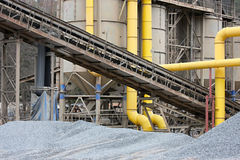 Stone quarry with silos and conveyor Stock Images