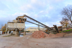 Stone quarry with silos Royalty Free Stock Photos