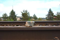 Stone on the rail royalty free stock images