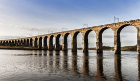 Stone Railway Viaduct Over The River Tweed. Railway viaduct over the river tweed at Berwick-upon-Tweed Stock Images