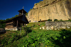 The Stone Ravens (Corbii de piatra ) monastery and wooden church from Corbi, Arges county, Romania. Stock Photos