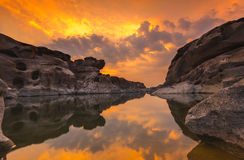 Stone reflecting water at sunset Stock Photo