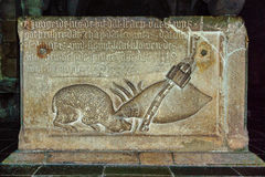 Stone relievo on the well in Lund Cathedral. Relievo by van Düren. Louse fixed with a chain is biting a sheep Royalty Free Stock Photos
