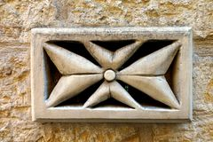 Maltese Cross. A stone representation of the Maltese cross, also known as the Amalfi Cross, is the symbol of the Order of the Knights of Malta. This cross was Stock Photos