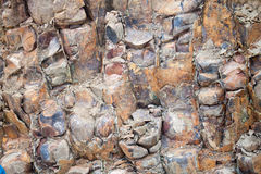 Stone Reserve basalt columns orange and dark blue. Royalty Free Stock Photo