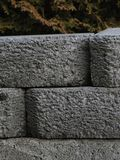 Stone Retaining Wall. A brick stone retaining wall.  Granite and grey, textured and stacked Stock Images