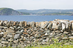 Stone retaining wall by the ocean Stock Image