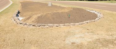 Stone Retaining Wall. A stone retaining wall in the process of being built stock image