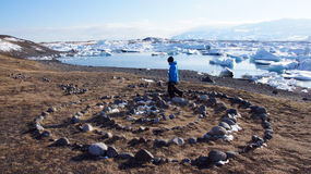 Stone ring and ice floating in Jokulsarlon in Iceland Stock Images