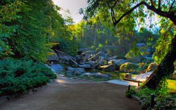 Stone river. River with a stone bridge and a small playground royalty free stock photo