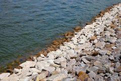 Stone river bank Royalty Free Stock Photo