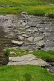 Stone river crossing, mountain stream Royalty Free Stock Image
