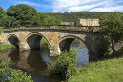 Stone road bridge over the River Derwent at Chatsworth house estate, Derbyshire.  royalty free stock photography