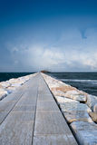 Stone road on the cape in a sea Stock Photo