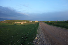 Stone road in grassland Stock Photos