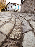 Stone road and an old house in Petrela, Albania. A road leading up to an old house, captured in small town Petrela in the countryside of Tirana Royalty Free Stock Images