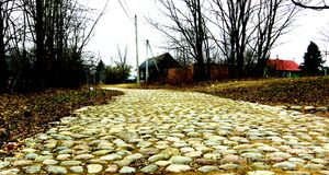 Stone road. Stone paved road near Izborsk fortress Royalty Free Stock Photos