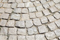 Stone road texture. Cobblestones. Close-up. Royalty Free Stock Images