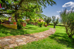 Stone road to the country house, Tuscany Stock Images