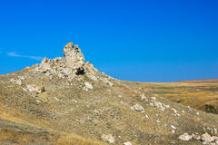Stone rock and field Royalty Free Stock Photo