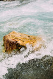 Stone Rock In Mountain River, Water Splashes Stock Photos