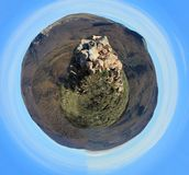 Stone rock towers over the landscape. Spherical panorama stock photos