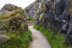 Stone rocks mountain hiking path at Irish seacoast Royalty Free Stock Photo