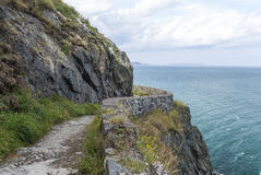Stone rocks mountain hiking path at Irish seacoast Stock Photos