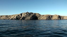 Stone rocks among the watery surface of Arctic Ocean on New Earth. stock footage