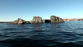 Stone rocks among the watery surface of Arctic Ocean on New Earth. stock video