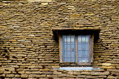 Stone roof. Typical old slate roof in Cotswolds, England Stock Photos
