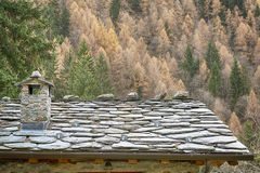 Stone roof of a mountain chalet Stock Images