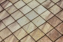 Stone roof pattern background. Brown stone tiles roof texture architecture background seamless pattern, detail of house close up Royalty Free Stock Photo
