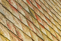 Stone roof pattern background. Brown stone tiles roof texture architecture background seamless pattern, detail of house close up Stock Photography
